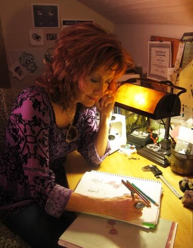 Kathleen sketching in her studio
