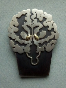 Silver and gold money clip (coronal brain view)