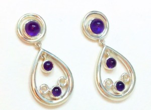 "Silvery glow and amethyst drops in the gleaming snow, 1 1/2"" long."