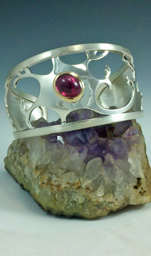 Nuclear cuff with pink tourmaline in 18kt bezel, silver