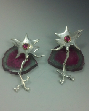 Rock your inner scientist with silver dangles, lit by luscious raspberry tourmaline nuclei in 18kt yellow gold bezel
