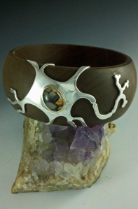 Snakeskin agate, silver & gold meet wood--and the chemistry is beautiful! Silver neuron wraps a re-purposed wood bangle for large wrist.