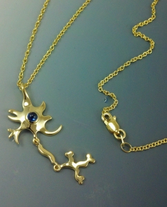 Golden cascade pendant, 18kt yellow gold and sapphire cabochon