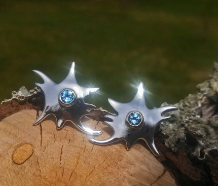 Spring has sprung--and we found these blooming on our fallen tree! Blue topaz post earring in gold and silver.